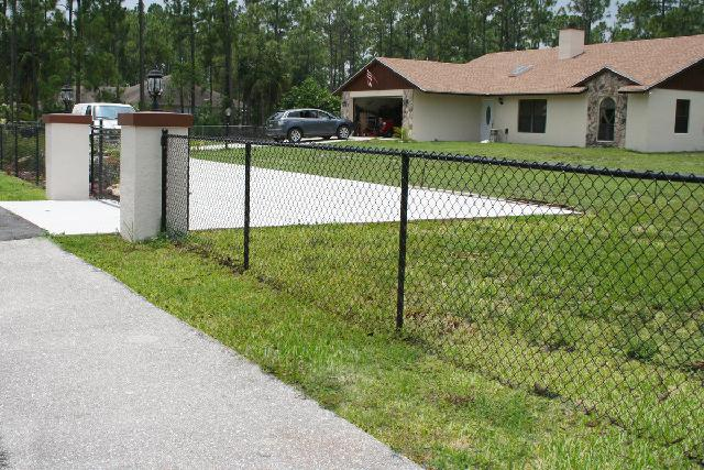 How to Install a Chain Link Privacy Fence | DoItYourself.com